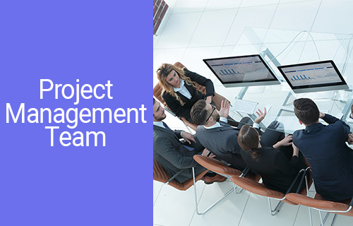 Project Management Team at work by the table